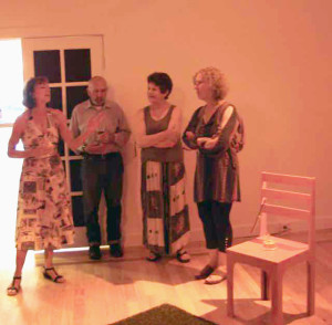 "Brenda Hanson (left), speaking about a portion of her installation, ""WITNESS."""
