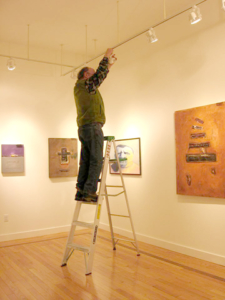 Adjusting lights in the gallery.