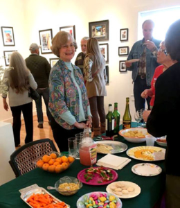 Joan Adams serving refreshments at a double opening
